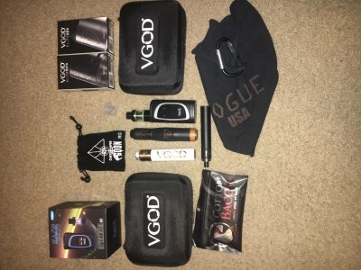 Vape kit with juice, mods, coils, batteries, and merch